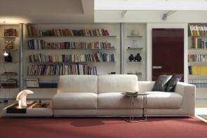 Grande divano angolare in tessuto con poggiatesta reclinabili Joe