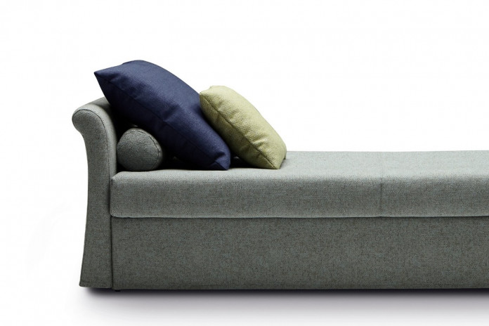 Roll cushion combined with decorative cushions for the sofa