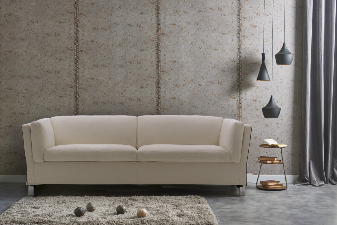 Benny is an elegant sofa bed with chromed bridge feet and high armrests