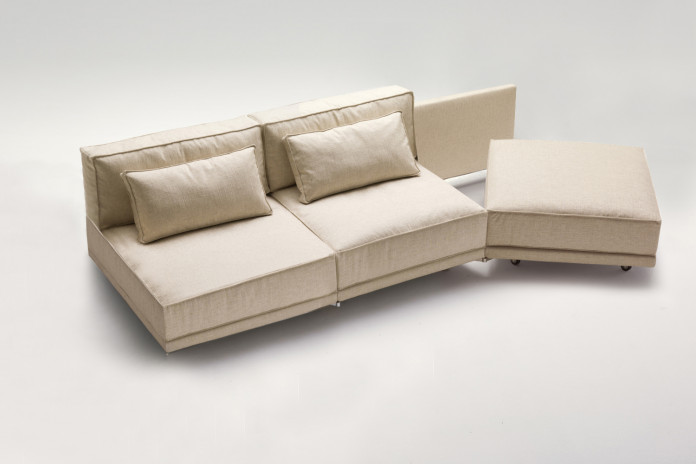 Dennis sofa bed with rotating seat and chaise longue equipped with optional armrest.