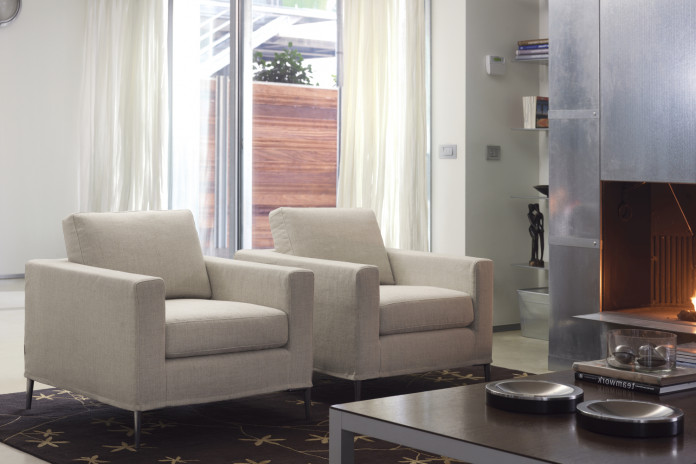 Grace is a modern armchair with high conical feet.