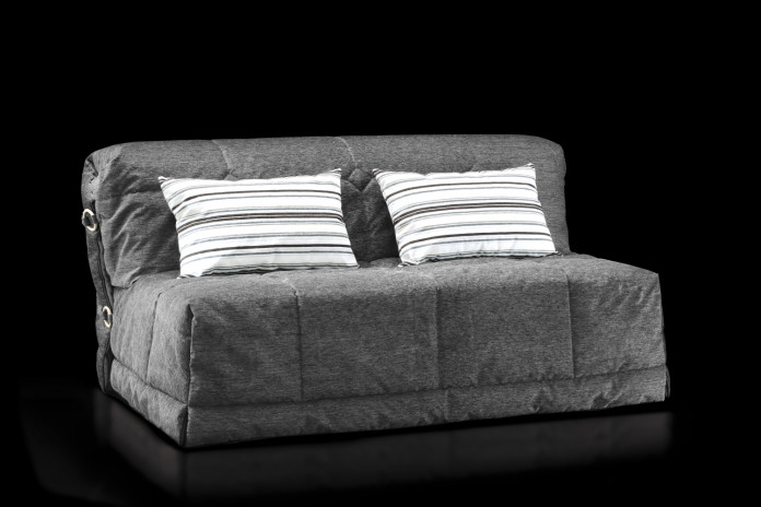 Gil folding sleeper sofa with decorative cushions.