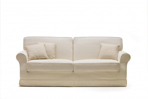 Gordon fabric sofa with curly armrests.