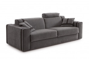 The sofa bed can be completed with an headrest cushion, decorative cushions and an ottoman