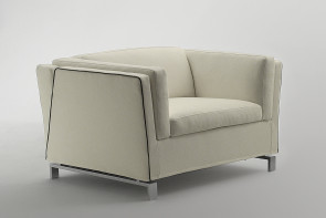Benny square shaped armchair with high armrests and a wide seat