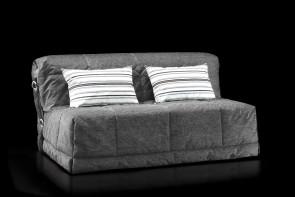 Gil folding sleeper sofa with decorative cushions.